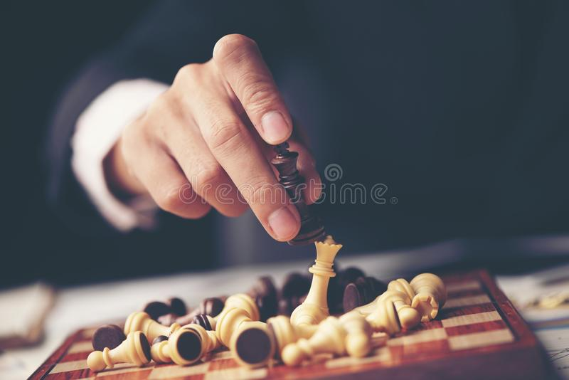 Businessman play with chess game. concept of business strategy a royalty free stock image