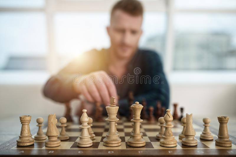Businessman play with chess game. concept of business strategy and tactic. Businessman play with chess game in office. concept of business strategy and tactic stock photos