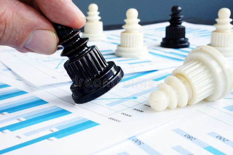 Businessman playing chess on business report. Strategy and leadership. stock image