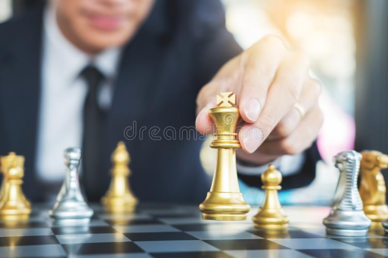 Businessman playing chess figure take a checkmate another king with team, strategy or management win or success concept royalty free stock image