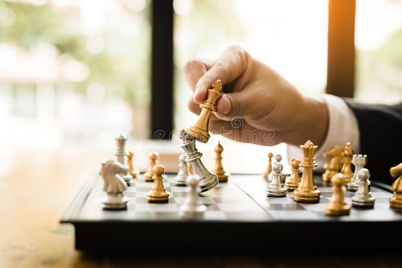 Businessman playing chess game beat opponent with strategy concept.  stock photos