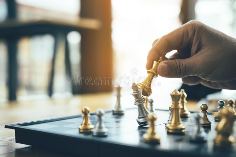 Businessman playing chess game beat opponent with strategy concept.  royalty free stock images