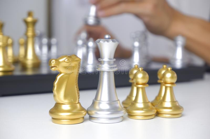 Businessman playing chess game; for business strategy, leadership and management concept. royalty free stock image
