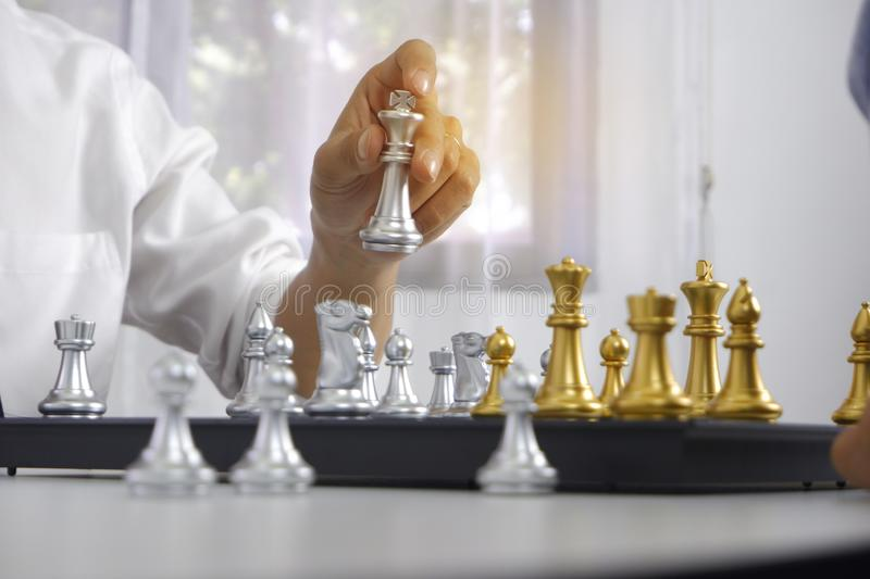 Businessman playing chess game; for business strategy, leadership and management concept stock photos