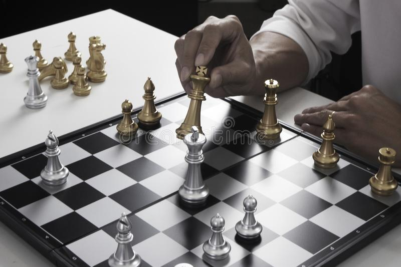Businessman playing chess game; for business strategy, leadership and management concept royalty free stock image