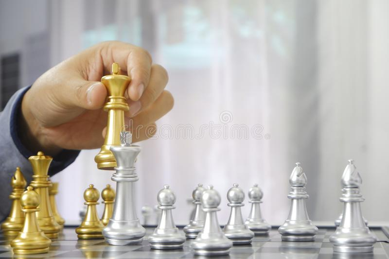 Businessman playing chess game; for business strategy, leadership and management concept royalty free stock images