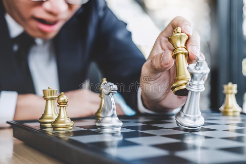 Businessman playing chess game reaching to plan strategy for success, thinking for planning overcoming difficulty and achieving. Goals business strategy for win royalty free stock photo