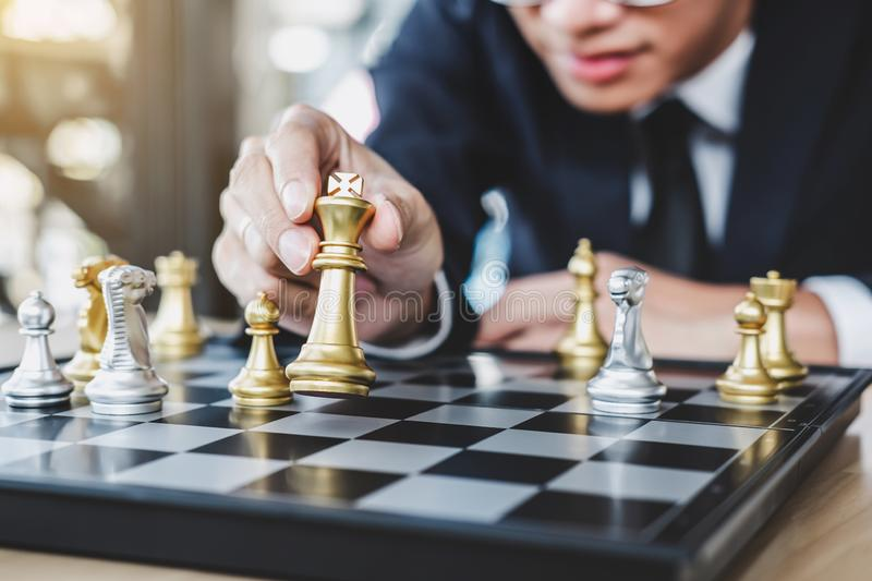 Businessman playing chess game reaching to plan strategy for success, thinking for planning overcoming difficulty and achieving. Goals business strategy for win royalty free stock images