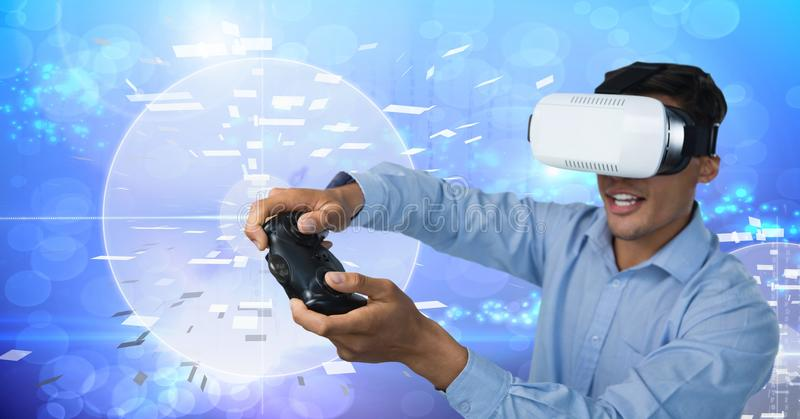 Businessman playing with computer game controller with virtual reality headset with technology backg. Digital composite of Businessman playing with computer game stock photos