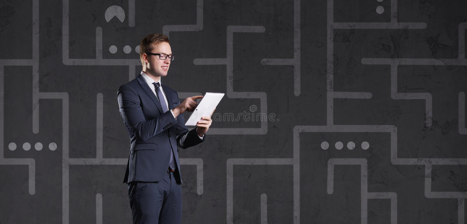 Businessman playing a game. Business, competition, challenge, co. Businessman playing a game. Business and competition stock images