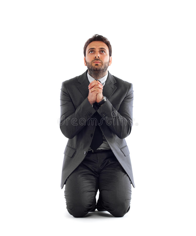 Businessman pleads in the kneeling royalty free stock photography
