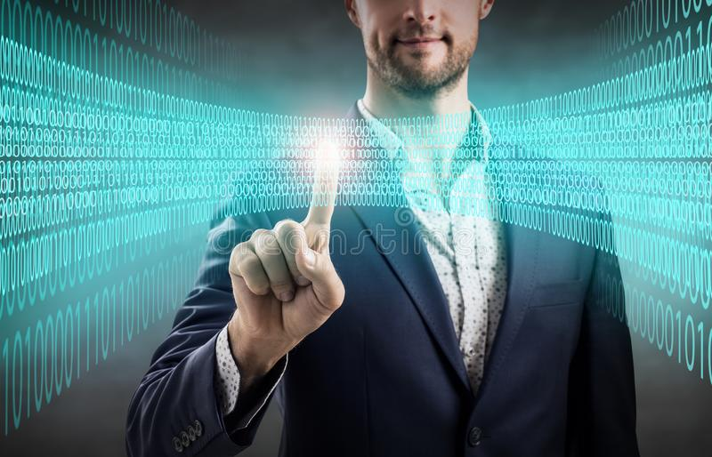 Businessman point on digital blue light in the matrix. royalty free stock photos