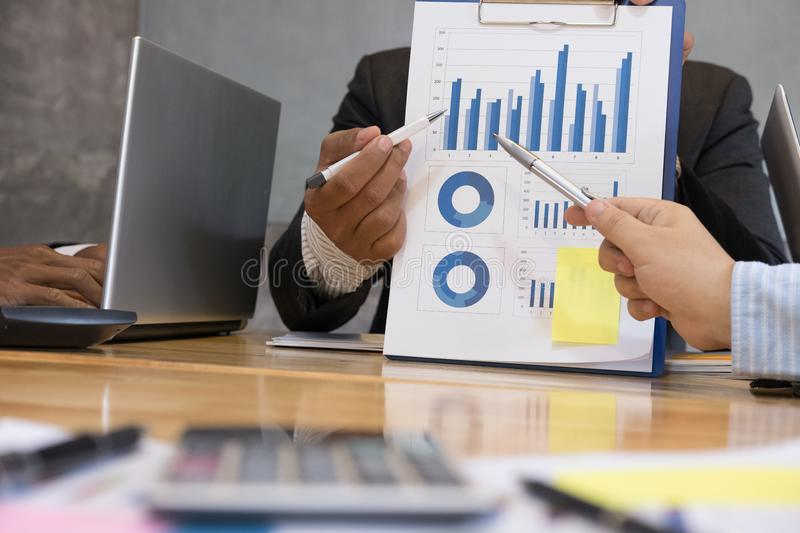 Businessman pointing at analytic financial accounting market chart. Business people present graph report summary. Start up young royalty free stock images