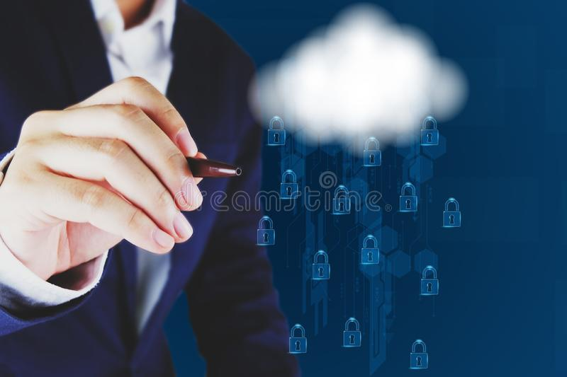 Businessman pointing a  cloud and lock icon.Cloud computing and network security concept stock photography