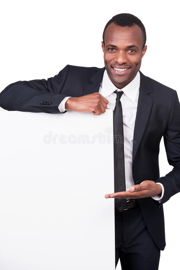 Businessman pointing a copy space. stock photo