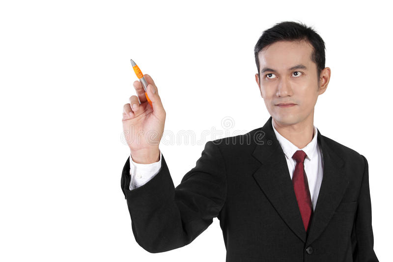Businessman pointing at copyspace with pen, isolated on white royalty free stock photo