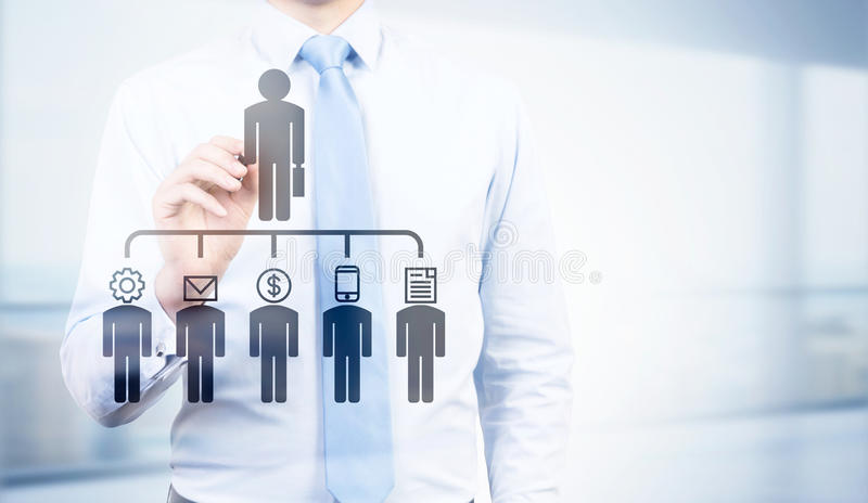 Businessman pointing at delegating pictogram royalty free stock photos