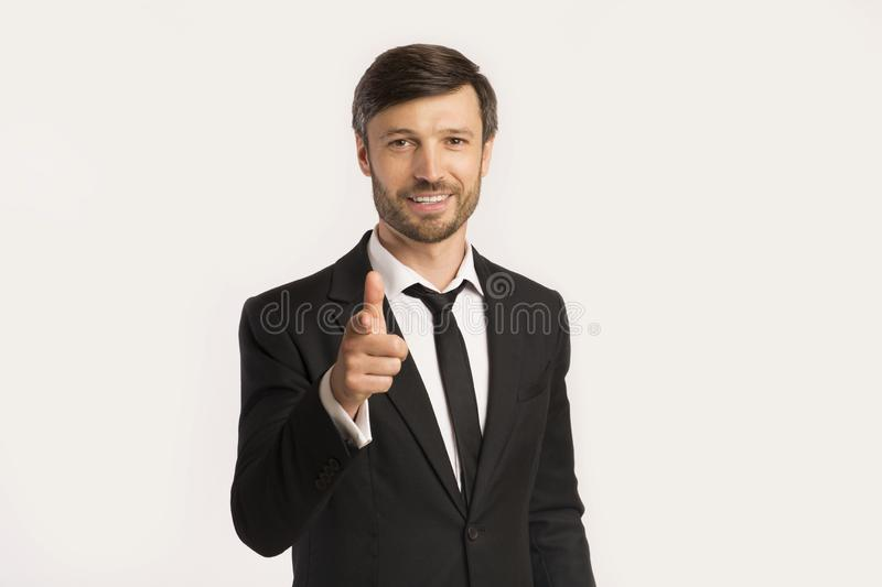 Businessman Pointing Finger At Camera Standing On White Background royalty free stock photos
