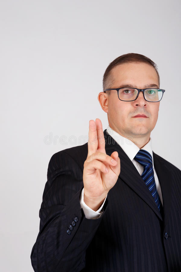 Businessman pointing gesture with two fingers raised together stock image