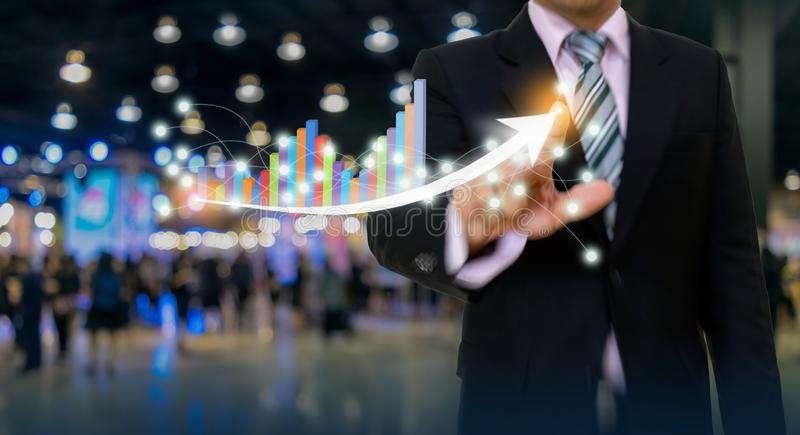 Businessman pointing graph and arrow concept development to success growing annual revenue. Growth royalty free stock photography