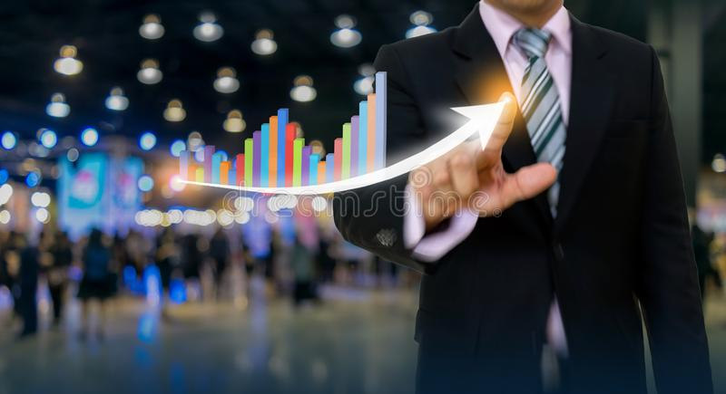 Businessman pointing graph and arrow concept development to success growing annual revenue. Growth stock images