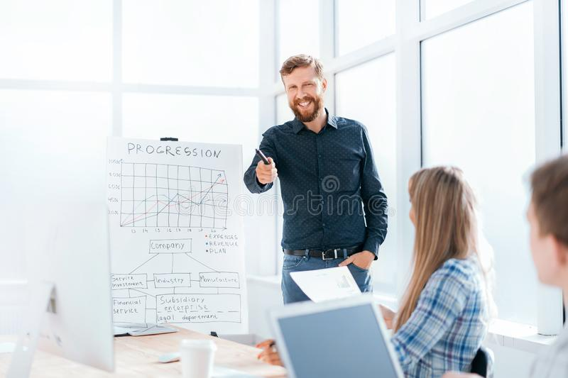 Businessman pointing at graph during the business presentation. Photo with copy space royalty free stock images