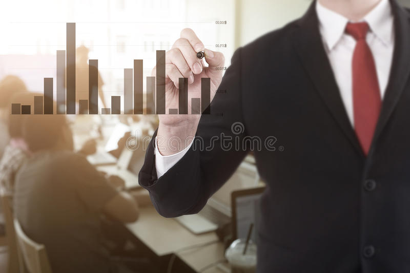 businessman pointing a graph in conference room for a talking. royalty free stock image