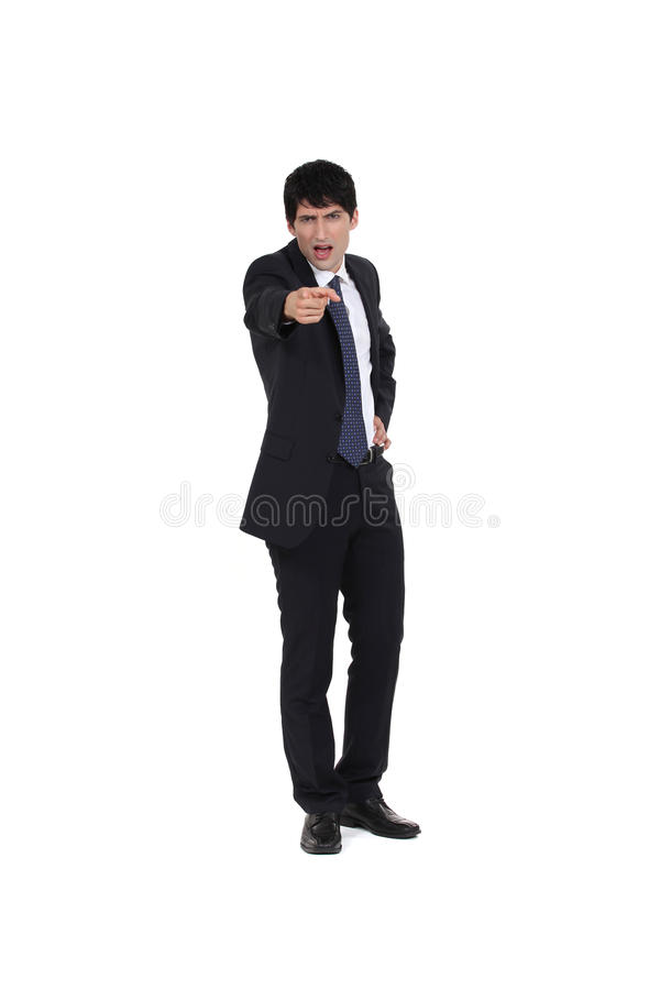 Businessman pointing his finger. Businessman angrily pointing his finger royalty free stock images