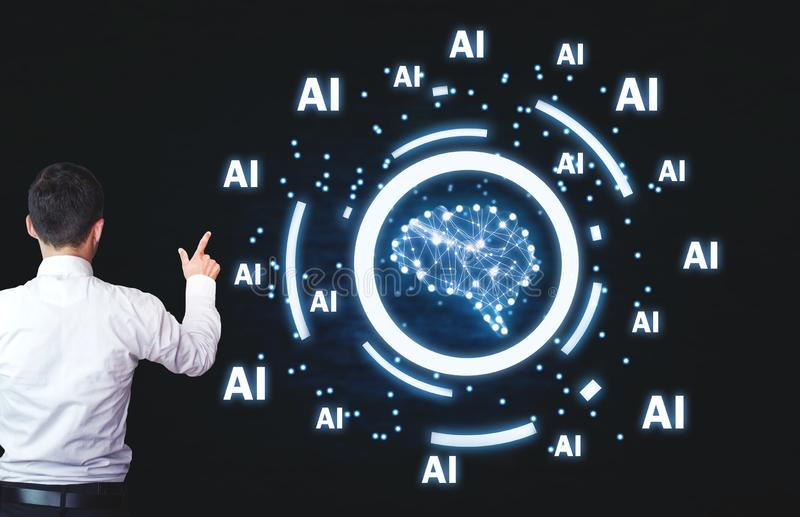 Businessman pointing Human brain with Ai words. Artificial intelligence concept royalty free stock photo