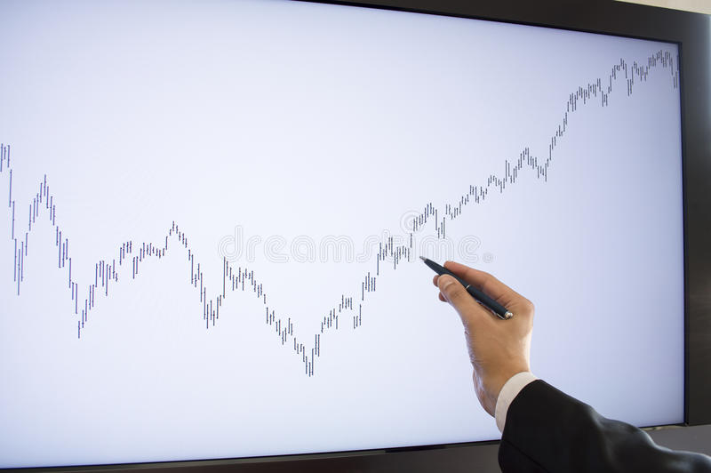 Download Businessman Pointing With Pen On The Monitor Stock Image - Image: 34779953