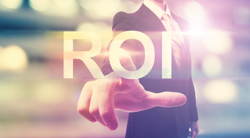 Businessman pointing at ROI (return on investment) stock photos