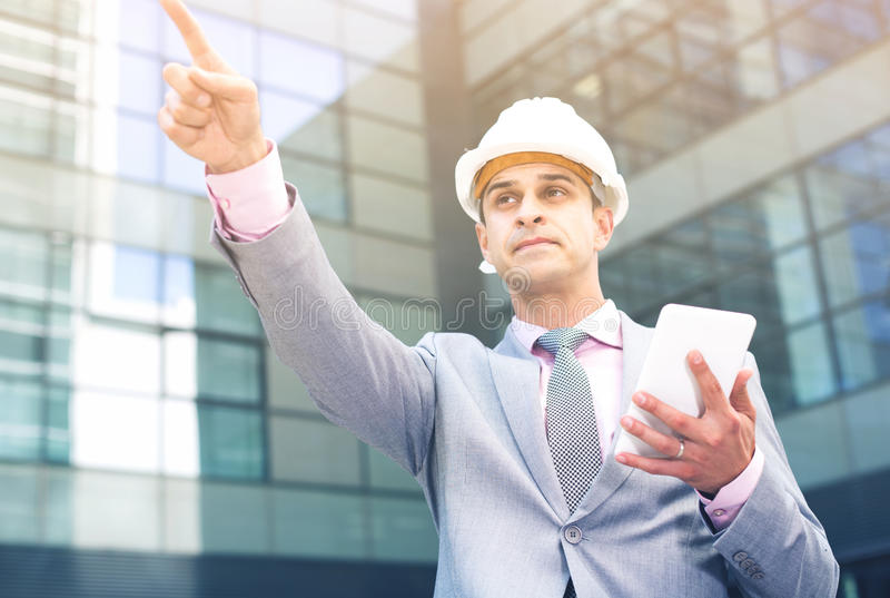 Businessman pointing at something stock photos