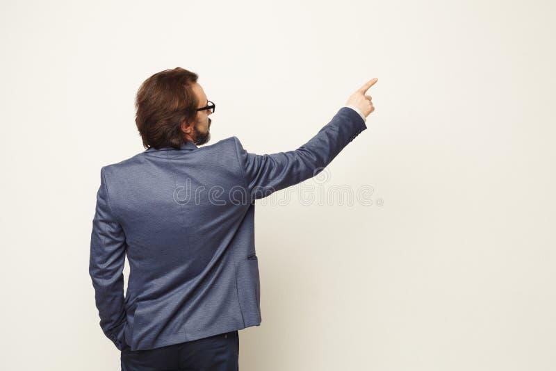Businessman pointing something on white background stock photo