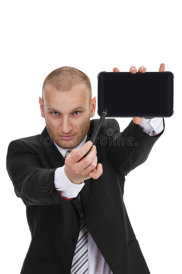 Businessman pointing with a sylus to a tablet phablet phone stock image