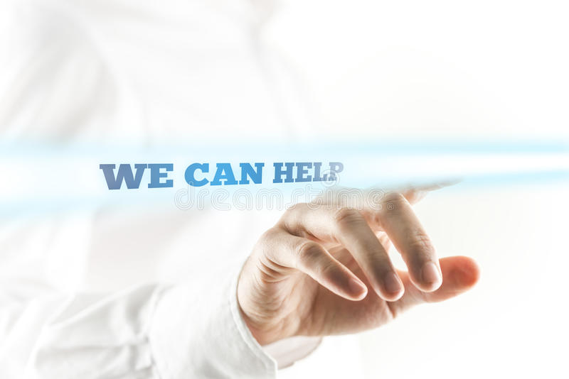 Businessman Pointing to We Can Help Sign royalty free stock photography