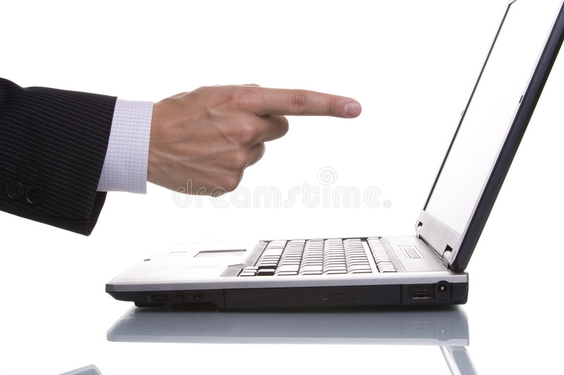 Businessman pointing to the laptop stock image