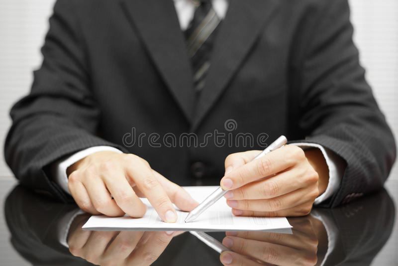 Businessman pointing to mistake in report royalty free stock images