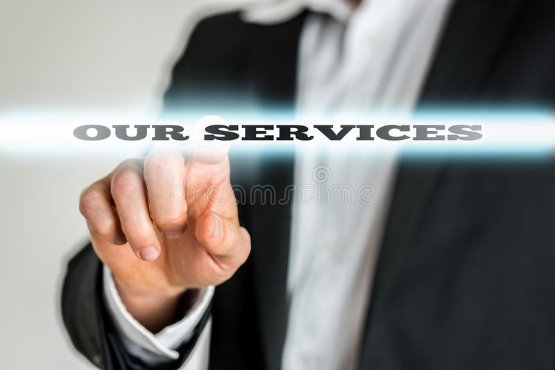 Businessman Pointing to Our Services Sign. Close Up of Businessman Finger Pointing to Highlighted Our Services Sign