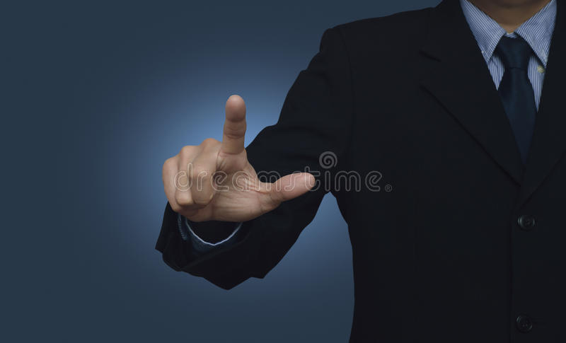 Businessman pointing to something or touching a touch screen on stock image