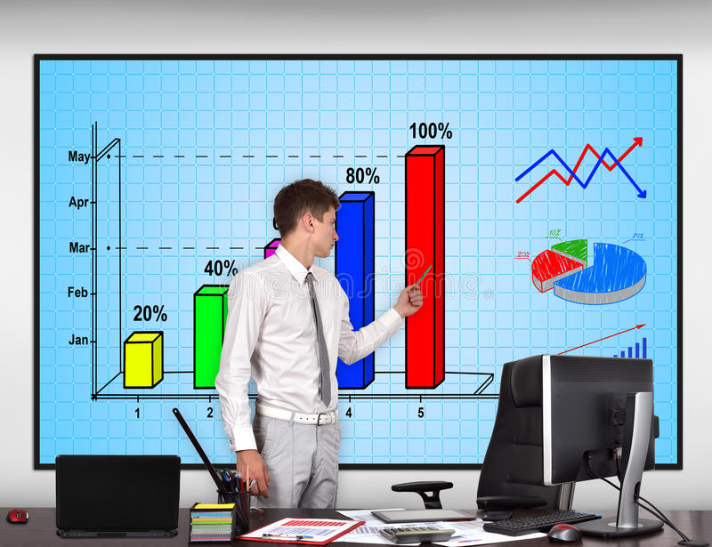 Businessman pointing to stock chart. Businessman in conference room pointing to stock chart on screen stock photo
