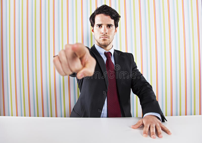 Businessman pointing to you stock images