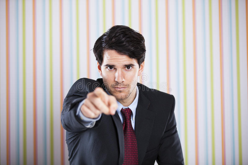 Businessman pointing to you stock photography