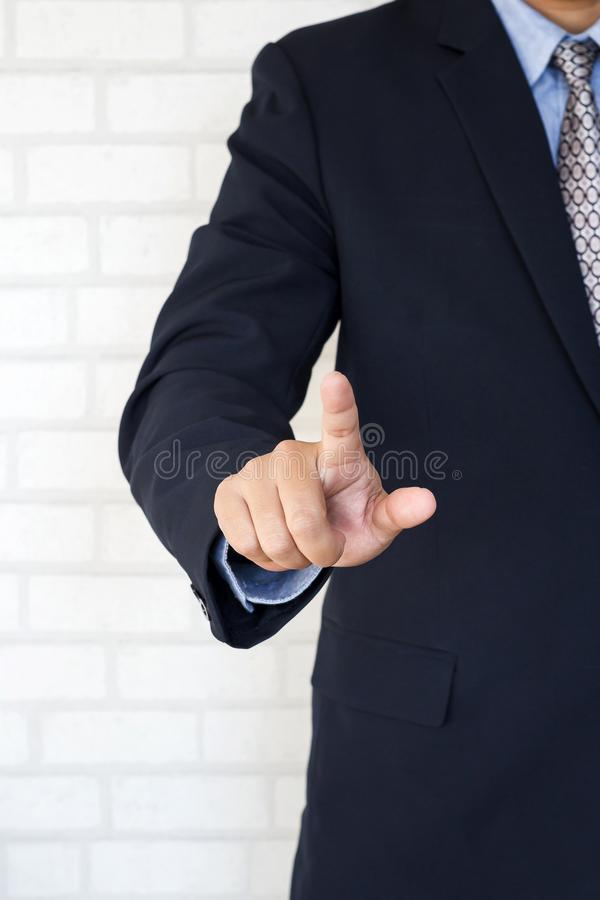 Businessman pointing or touching a touch screen royalty free stock photography