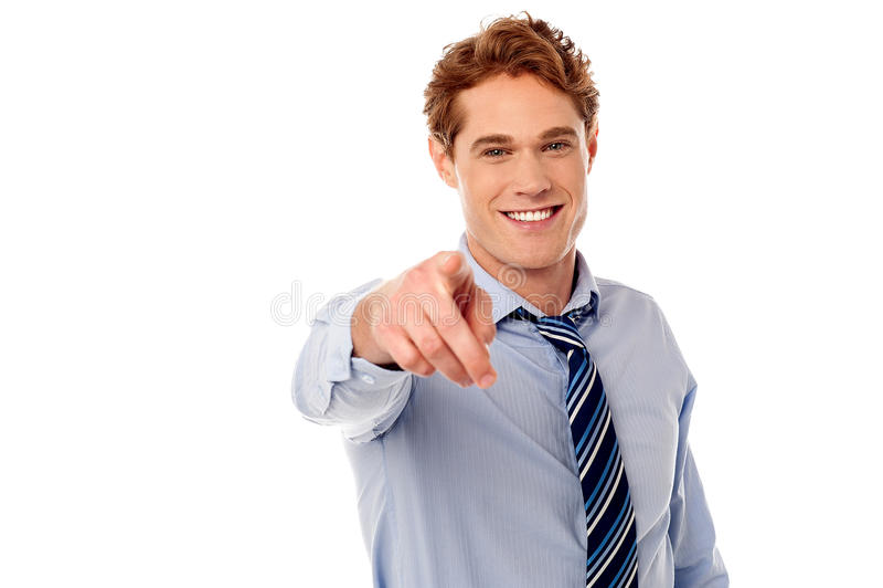Businessman pointing towards camera stock photography