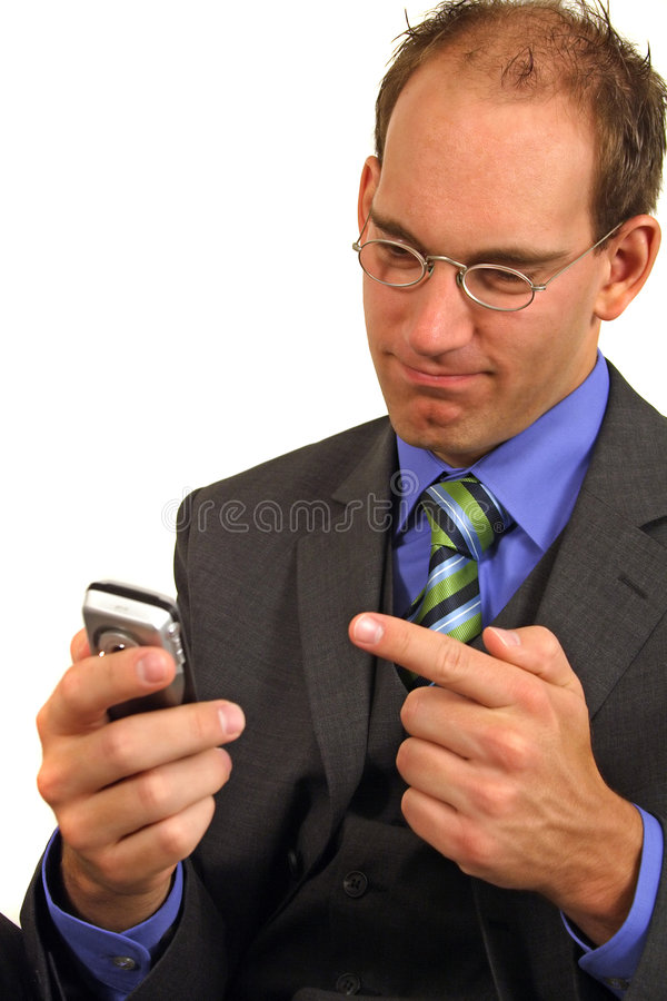 Businessman points at phone royalty free stock image