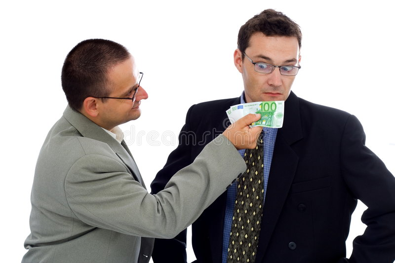 Businessman/politician bribe. Businessman or politician showing some euros royalty free stock images