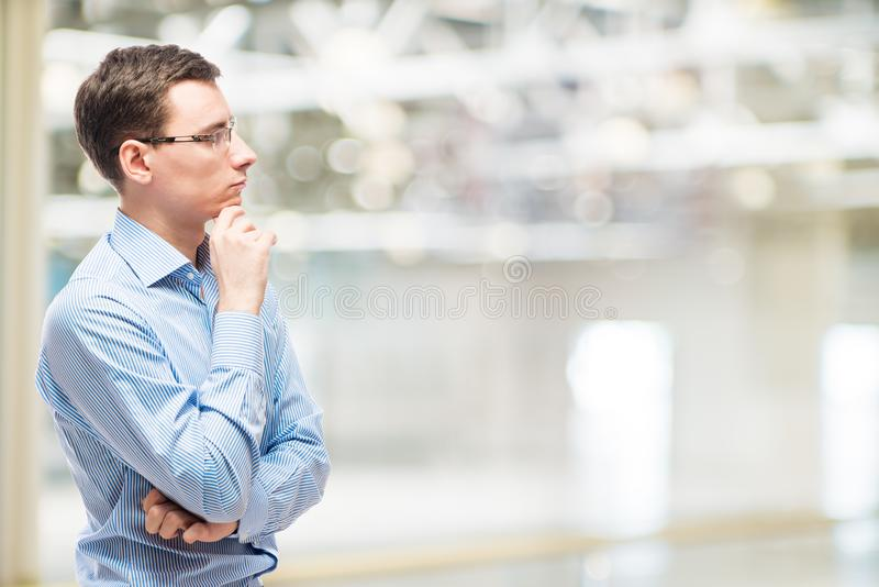 Businessman pondering business strategy, portrait royalty free stock image