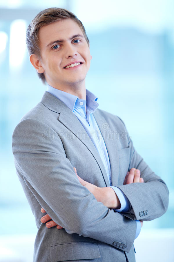 Businessman. Portrait of cheerful businessman looking at camera with smile stock image