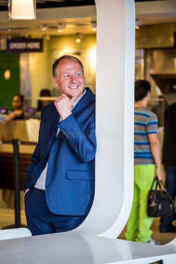 Businessman portrait in a public place. Businessman portrait in restaurant area at the airport stock images