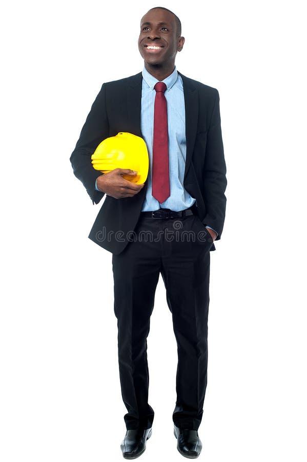Businessman posing with construction helmet stock photos